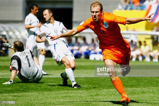 Arjen Robben of the Netherlands celebrates scoring his team's first goal during the FIFA World Cup Germany 2006 Group C match between Serbia and...