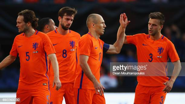 Arjen Robben of the Netherlands celebrates scoring his teams second goal of the game with team mates during the International Friendly match between...