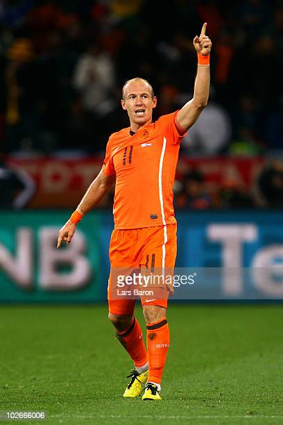 Arjen Robben of the Netherlands celebrates scoring his team's third goal during the 2010 FIFA World Cup South Africa Semi Final match between Uruguay...
