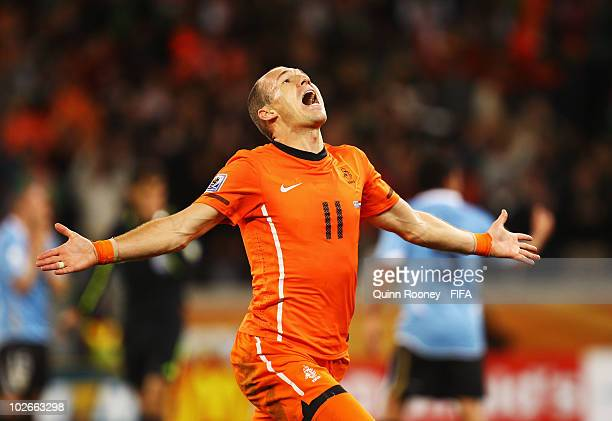 Arjen Robben of the Netherlands celebrates scoring the third goal during the 2010 FIFA World Cup South Africa Semi Final match between Uruguay and...
