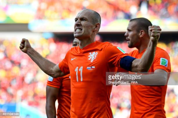 Arjen Robben of the Netherlands celebrates setting up his team's second goal by Memphis Depay during the 2014 FIFA World Cup Brazil Group B match...