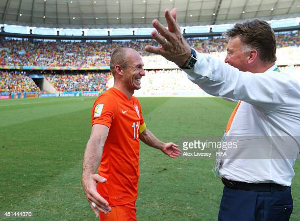 Arjen Robben of the Netherlands celebrates the 21 win with head coach Louis van Gaal after the 2014 FIFA World Cup Brazil Round of 16 match between...