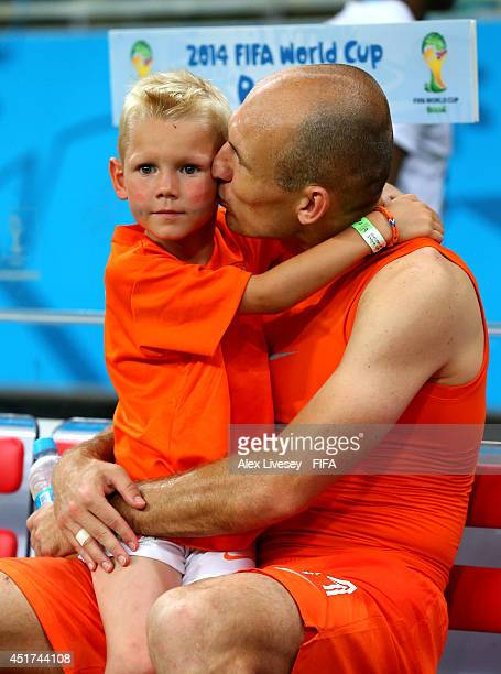 Arjen Robben of the Netherlands celebrates the win with his son Luka after the 2014 FIFA World Cup Brazil Quarter Final match between Netherlands and...
