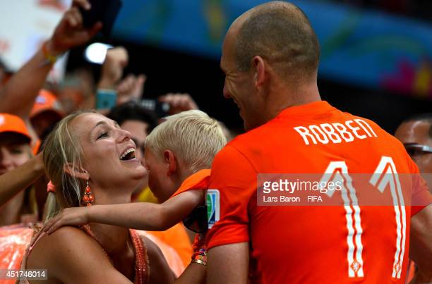 Arjen Robben of the Netherlands celebrates the win with his wife Bernadien after the 2014 FIFA World Cup Brazil Quarter Final match between...