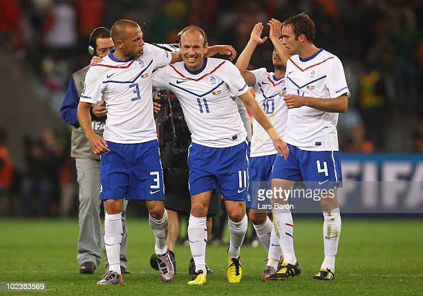 Arjen Robben of the Netherlands celebrates with team mate John Heitinga after Klaas Jan Huntelaar scores his side's second goal during the 2010 FIFA...