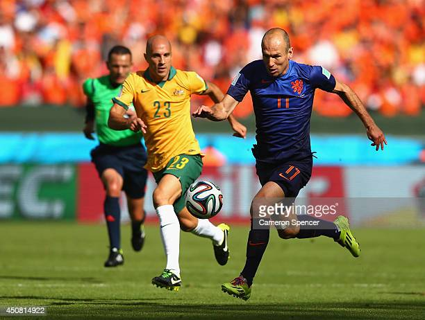 Arjen Robben of the Netherlands controls the ball on his way to scoring his team's first goal during the 2014 FIFA World Cup Brazil Group B match...