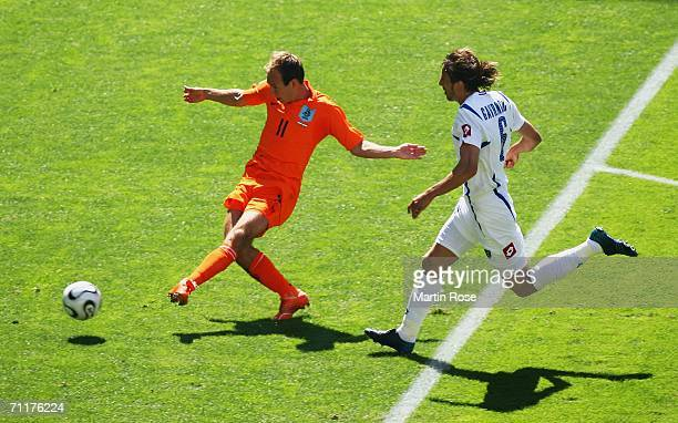 Arjen Robben of the Netherlands eludes Goran Gavrancic of Serbia and Montenegro to score his team's first goal during the FIFA World Cup Germany 2006...