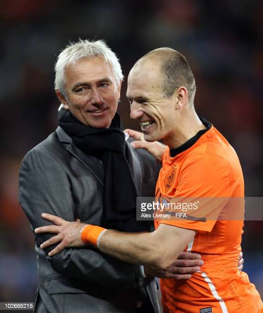 Arjen Robben of the Netherlands embraces Bert van Marwijk head coach of the Netherlands as he is substituted during the 2010 FIFA World Cup South...