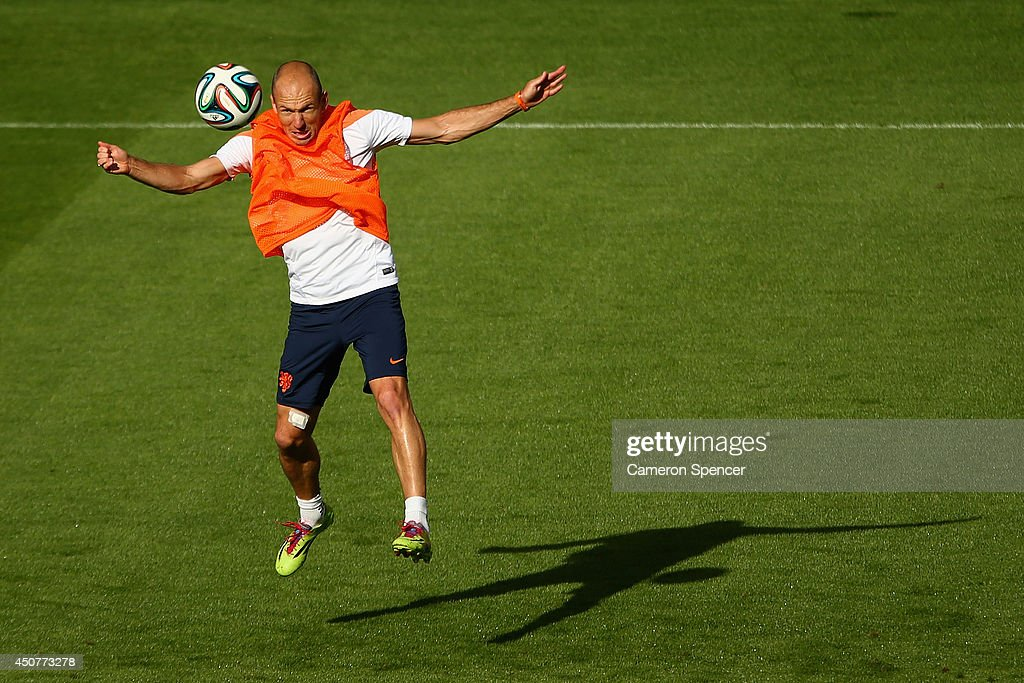 Arjen Robben of the Netherlands heads the ball during a Netherlands training session and press conference at Estadio Beira-Rio on June 17, 2014 in Porto Alegre, Brazil.