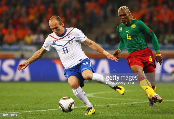 Arjen Robben of the Netherlands in action against Rigobert Song of Cameroon during the 2010 FIFA World Cup South Africa Group E match between...