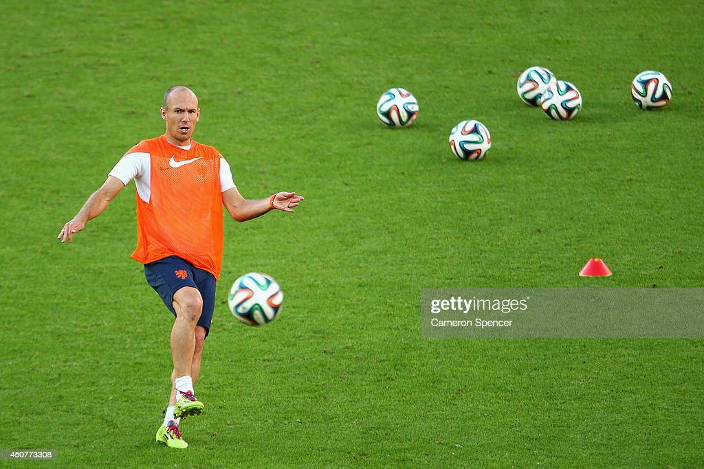 Arjen Robben of the Netherlands practices kicking for goal during a Netherlands training session and press conference at Estadio Beira-Rio on June 17, 2014 in Porto Alegre, Brazil.