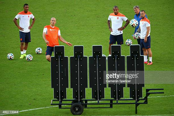 Arjen Robben of the Netherlands practices kicking for goal during a Netherlands training session and press conference at Estadio BeiraRio on June 17...