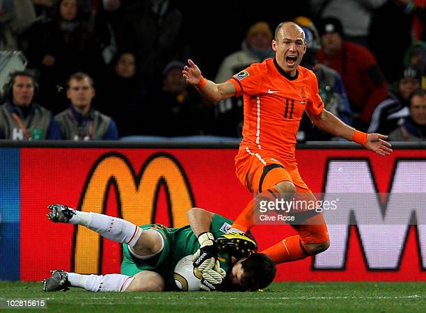 Arjen Robben of the Netherlands reacts to the referee as Iker Casillas of Spain collects the ball during the 2010 FIFA World Cup South Africa Final...