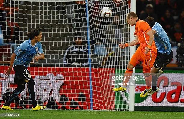 Arjen Robben of the Netherlands scores his team's third goal during the 2010 FIFA World Cup South Africa Semi Final match between Uruguay and the...
