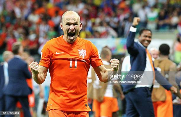Arjen Robben of the Netherlands screams as he celebrates victory after the 2014 FIFA World Cup Brazil Quarter Final match between the Netherlands and...