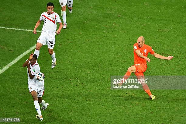 Arjen Robben of the Netherlands shoots as Junior Diaz of Costa Rica is called for a hand ball during the 2014 FIFA World Cup Brazil Quarter Final...