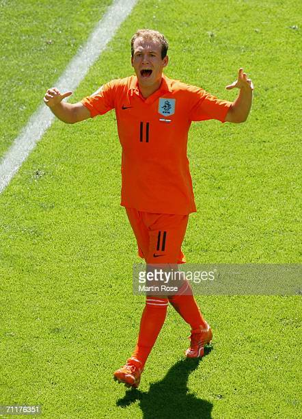 Arjen Robben of the Netherlands shows his frustration to the linesman during the FIFA World Cup Germany 2006 Group C match between Serbia and...