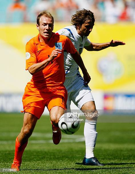 Arjen Robben of the Netherlands tussles for posession with Goran Gavrancic of Serbia and Montenegro during the FIFA World Cup Germany 2006 Group C...