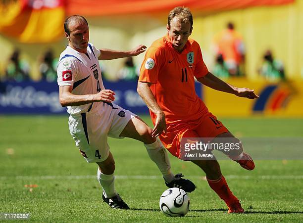 Arjen Robben of the Netherlands tussles for posession with Igor Duljaj of Serbia and Montenegro during the FIFA World Cup Germany 2006 Group C match...