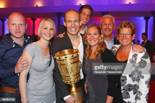 Arjen Robben pose with the trophy together with his family the Bayern Muenchen Champions Party after the DFB Cup Final match against Werder Bremen at...