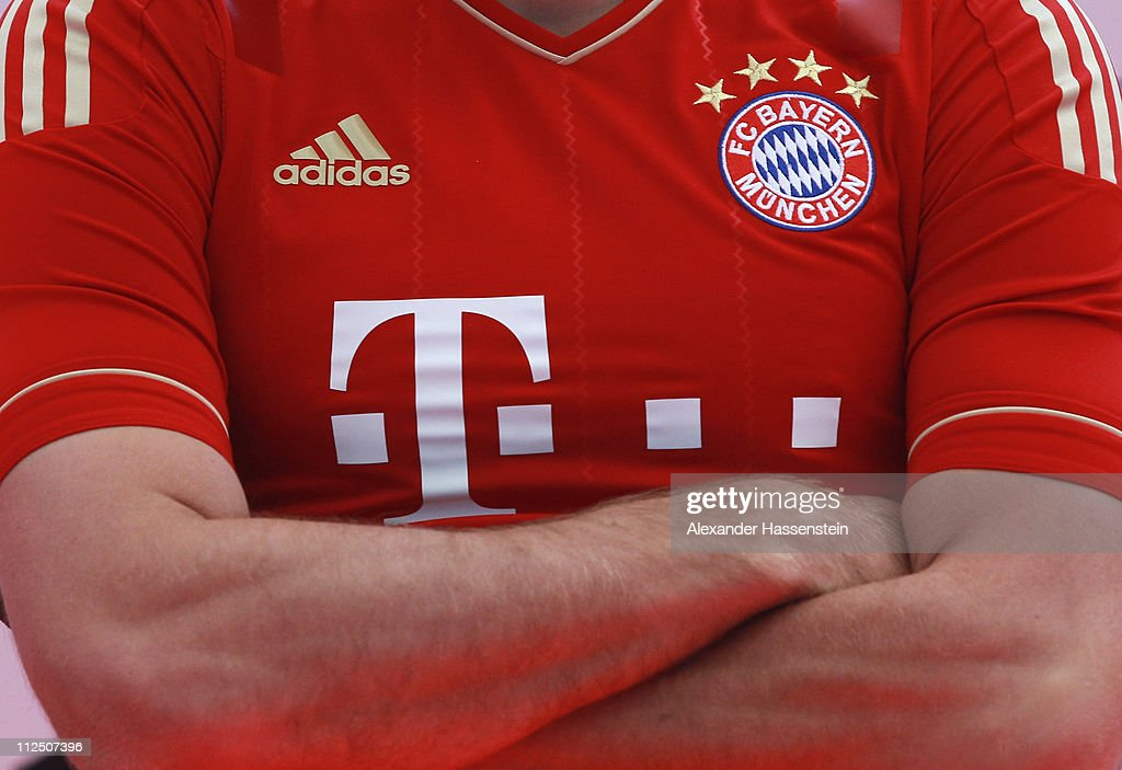Arjen Robben poses in the new FC Bayern Muenchen home jersey for the season 2011/12 at Allianz Arena on April 19, 2011 in Munich, Germany.