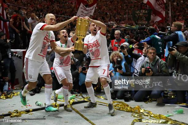 Arjen Robben Rafinha and Franck Ribery of Bayern Munich celebrate with the DFB Pokal following their last game for Bayern Munich and their victory in...