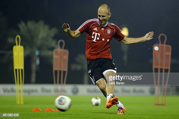 Arjen Robben shoots the ball during a training session at day 4 of the Bayern Muenchen training camp at ASPIRE Academy for Sports Excellence on...