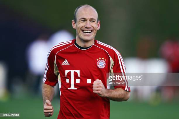 Arjen Robben smiles during a training session of Bayern Muenchen at the ASPIRE Academy for Sports Excellence on January 4 2012 in Doha Qatar