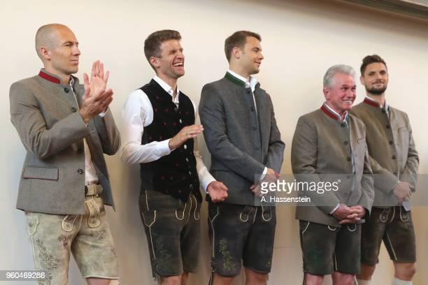 Arjen Robben Thomas Mueller Manuel Neuer head coach Jupp Heynckes and Sven Ulreich of Bayern Muenchen celebrate winning the German Championship title...