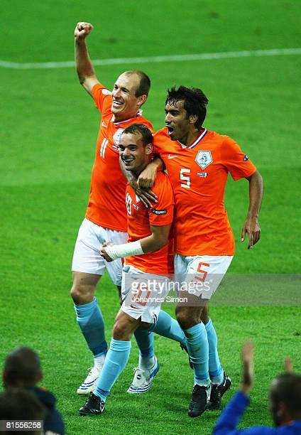 Arjen Robben, Wesley Sneijder and Giovanni van Bronckhorst celebrate with team mates after winning the UEFA EURO 2008 Group C match between...