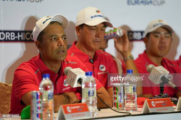 Arjun Atwal captain of team Asia speaks while Zhang Lianwei looks on during the post match press conference after the presentation ceremony following...