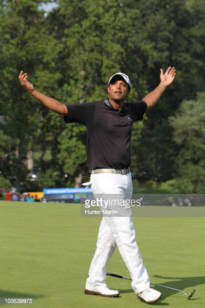 Arjun Atwal reacts on the 18th hole after winning the Wyndham Championship at Sedgefield Country Club on August 22 2010 in Greensboro North Carolina