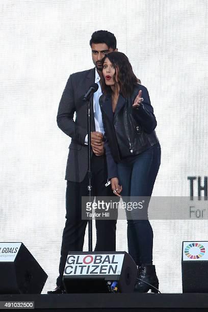 Arjun Kapoor and Freida Pinto speak during the 2015 Global Citizen Festival at Central Park on September 26 2015 in New York City
