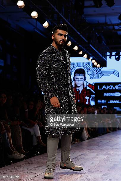 Arjun Kapoor walks the runway during the Kunal Rawal show on day 4 of Lakme Fashion Week Summer/Resort 2015 at Palladium Hotel on March 21 2015 in...