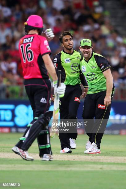 Arjun Nair and Aiden Blizzard of the Thunder celebrate the wicket of Moises Henriques of the Sixers during the Big Bash League match between the...