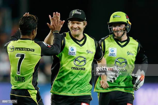 Arjun Nair and Shane Watson of the Sydney Thunder celebrates a wicket during the Big Bash League match between the Hobart Hurricanes and the Sydney...