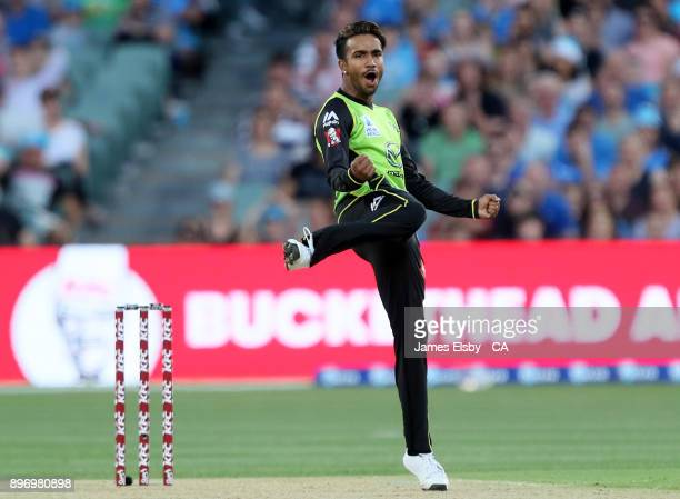 Arjun Nair of the Sydney Thunder celebrates the wicket of Alex Carey of the Adelaide Strikers during the Big Bash League match between the Adelaide...