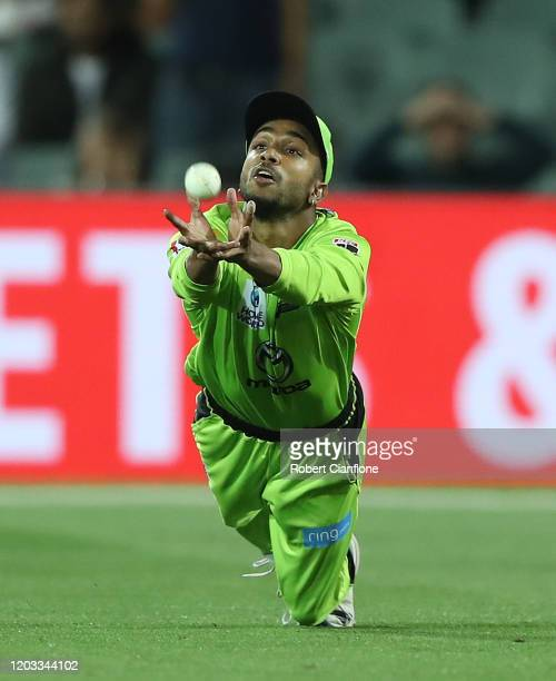 Arjun Nair of the Sydney Thunder takes a catch to dismiss Michael Neser of the Strikers during the Big bash League Finals match between the Adelaide...