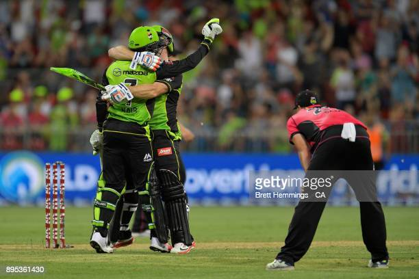 Arjun Nair of the Thunder and Aiden Blizzard of the Thunder celebrate victory during the Big Bash League match between the Sydney Thunder and the...