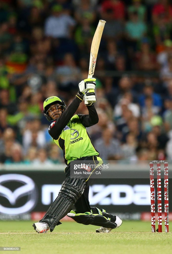Arjun Nair of the Thunder bats during the Big Bash League match between the Sydney Thunder and the Melbourne Renegades at Manuka Oval on January 24, 2018 in Canberra, Australia.
