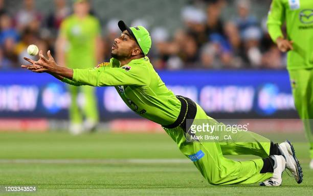 Arjun Nair of the Thunder catches Michael Neser of the Strikers during the Big bash League Finals match between the Adelaide Strikers and the Sydney...
