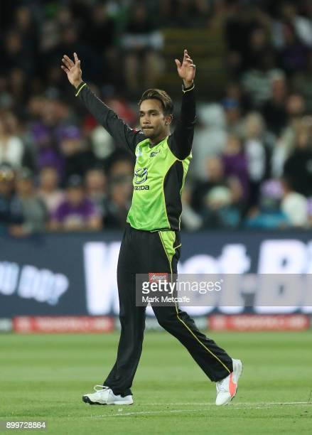 Arjun Nair of the Thunder celebrates taking a wicket during the Big Bash League match between the Hobart Hurricanes and the Sydney Thunder at...