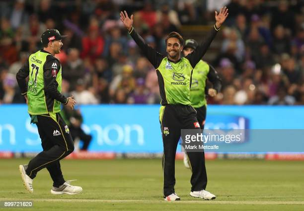 Arjun Nair of the Thunder celebrates taking the wicket of Matthew Wade of the Hurricanes during the Big Bash League match between the Hobart...