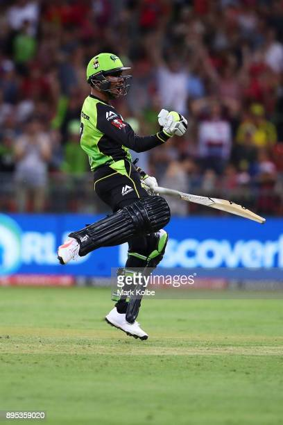 Arjun Nair of the Thunder celebrates victory during the Big Bash League match between the Sydney Thunder and the Sydney Sixers at Spotless Stadium on...
