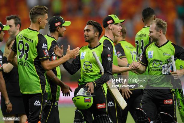 Arjun Nair of the Thunder celebrates victory with team mates during the Big Bash League match between the Sydney Thunder and the Sydney Sixers at...