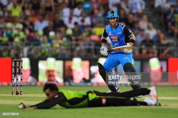 Arjun Nair of the Thunder fields a ball hit by Colin Ingram of the Strikers during the Big Bash League match between the Sydney Thunder and the...