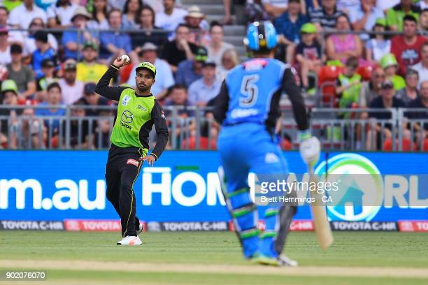 Arjun Nair of the Thunder fields the ball during the Big Bash League match between the Sydney Thunder and the Adelaide Strikers at Spotless Stadium...