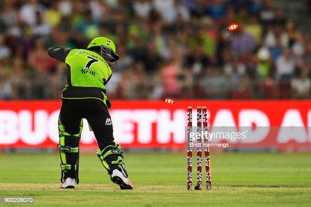 Arjun Nair of the Thunder is bowled out by Jofra Archer of the Hurricanes during the Big Bash League match between the Sydney Thunder and the Hobart...