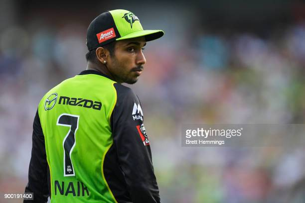 Arjun Nair of the Thunder looks on during the Big Bash League match between the Sydney Thunder and the Hobart Hurricanes at Spotless Stadium on...
