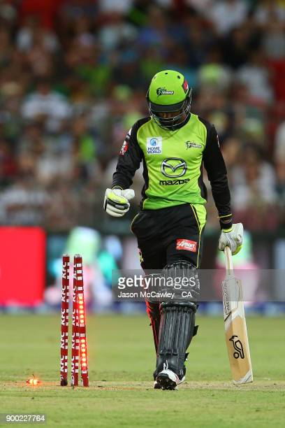 Arjun Nair of the Thunder walks back to the pavilion after being dismissed by Jofra Archer of the Hurricanes during the Big Bash League match between...